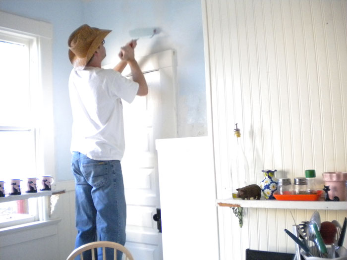 Painting the kitchen blue.