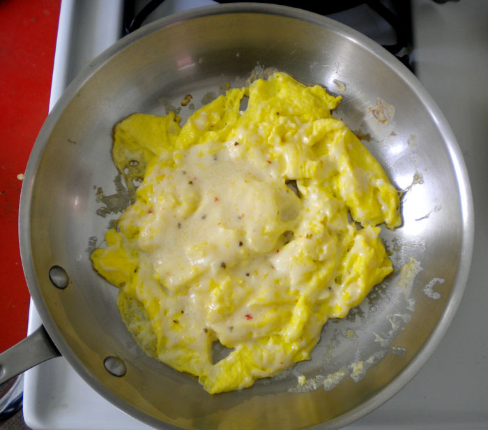 Scrambled eggs with pepper jack cheese.