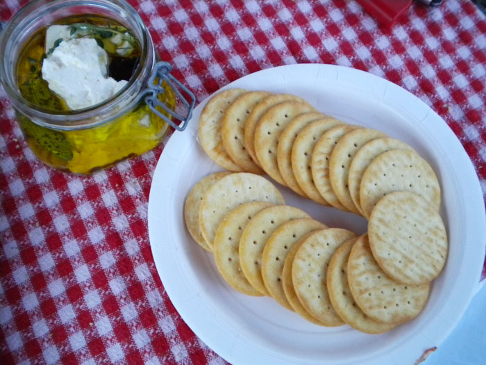 Marinated feta with crackers.
