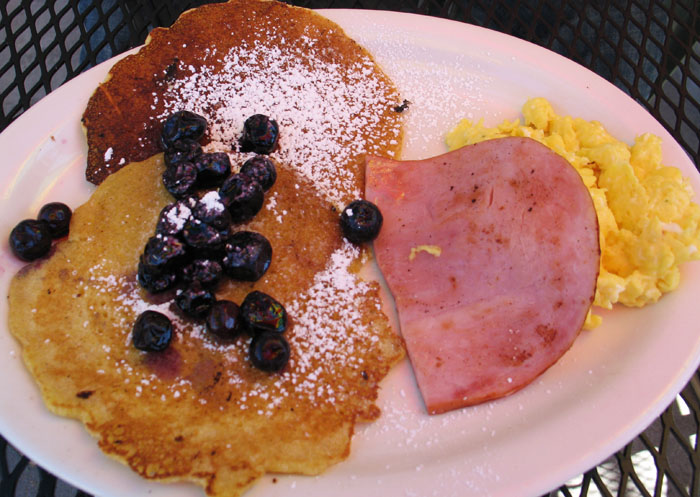Cornmeal pancakes with blueberries, scrambled eggs, and ham from Smiley's, Colorado Springs, CO