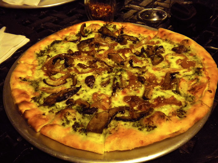 Pesto carmelized onion, and wild mushroom pizza from Kaos Pizza, Denver, CO