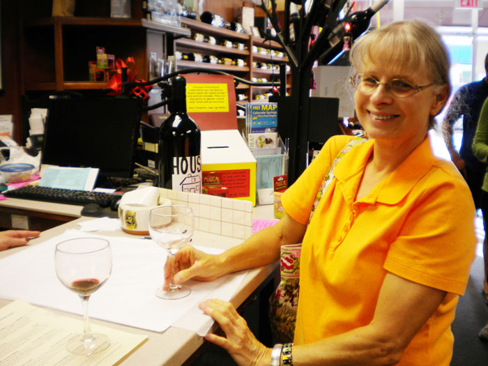 Linda tasting a nice Barbera at Vintages in Colorado Springs, CO