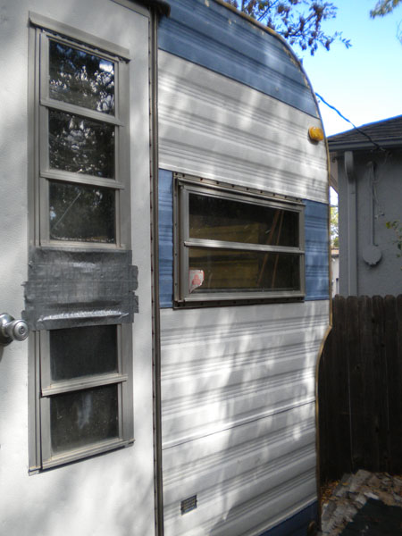 The travel trailer front door, with duct tape.