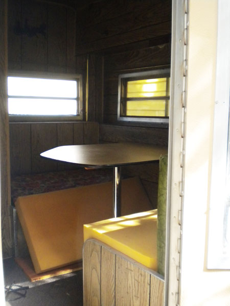 The dining table in the vintage travel trailer.
