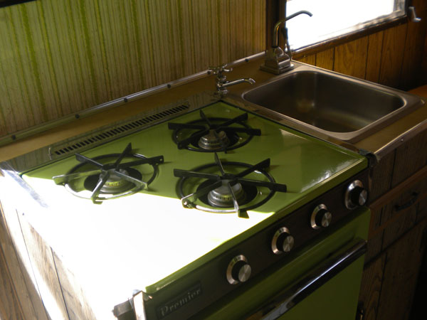 The stove in the vintage travel trailer.