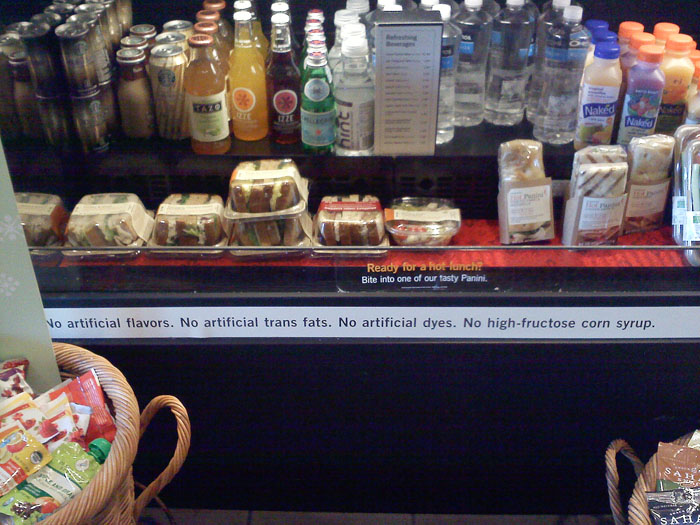 Starbucks sign declaring no trans-fats or high-fructose corn syrup.