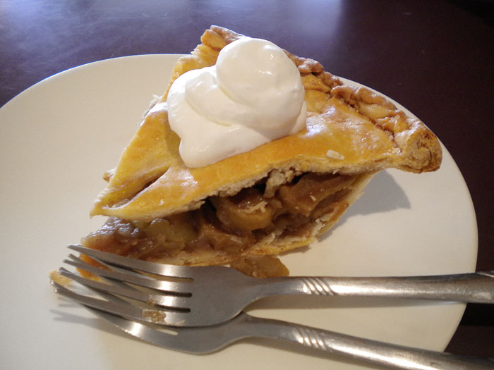 A slice of organic apple pie made by a local pie lady.