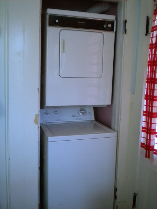 Done! Washer and dryer back into their weird little home. That closet should be slightly less cold now.
