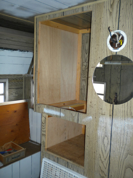 Vintage travel trailer project after removing the ice box and doing some priming.