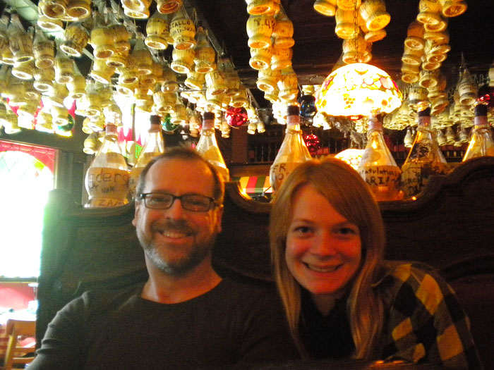 Mike and Tori under a ceiling of Chianti bottles at Micelli's, Hollywood