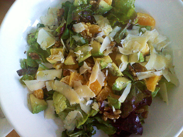 Arugula, red leaf lettuce, oranges, avocado, walnuts, parmesan, with orange juice, white balsamic and olive oil dressing.