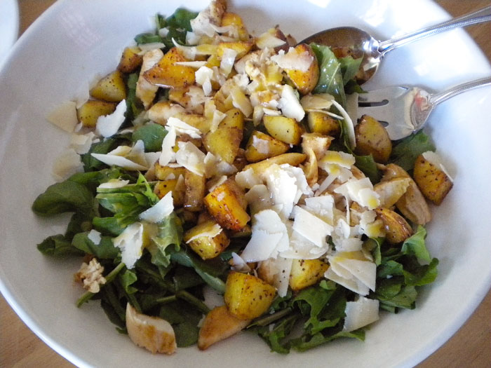 Arugula, roasted chicken, roasted potatoes, parmesan, with white balsamic, lemon juice, mustard, and olive oil dressing.