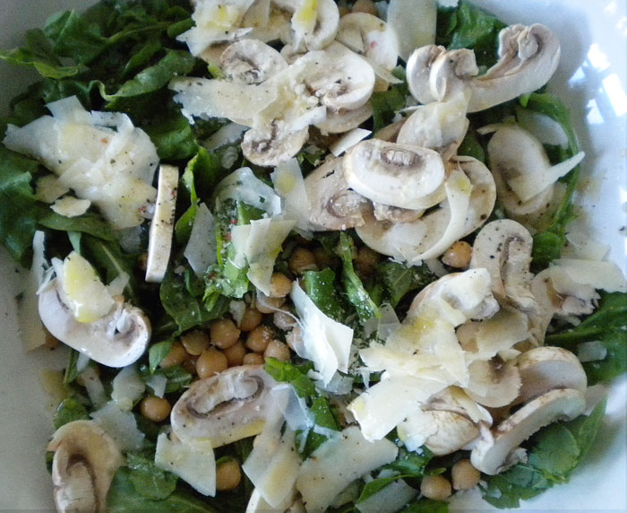 Arugula, garbanzo beans, mushrooms, parmesan, with herbed sea salt, white balsamic, and olive oil dressing.