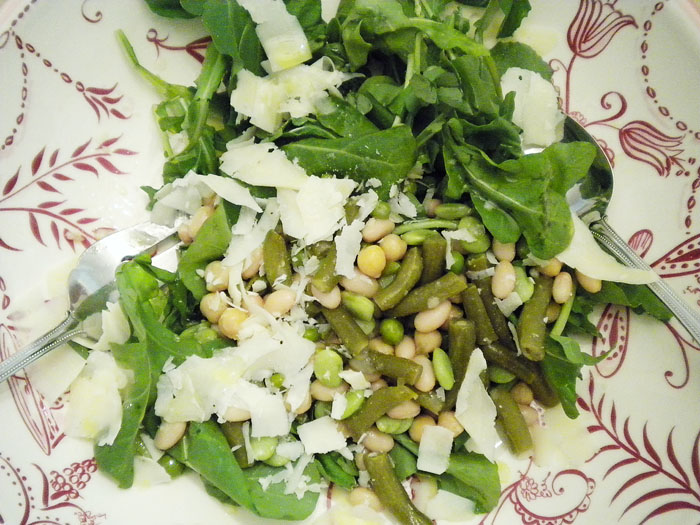 Arugula with roasted lima beans, peas, green beans, garbanzo beans, white beans, parmesan, with lemon juice and olive oil dressing.
