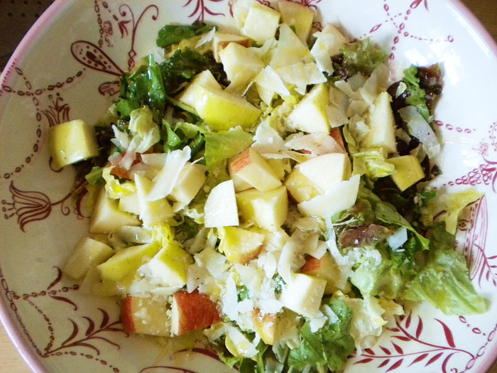 Red leaf lettuce with apples, parmesan, and balsamic and olive oil dressing.