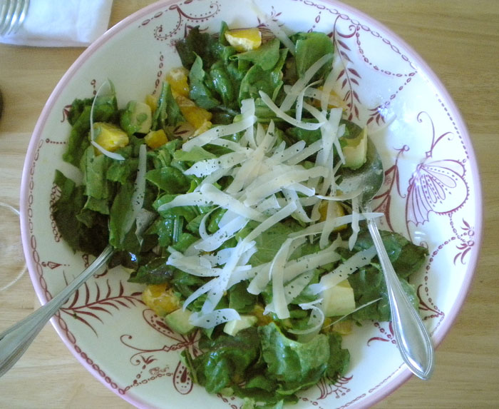Arugula and green leaf lettuce with oranges, avocado, parmesan, and white balsamic and olive oil dressing.