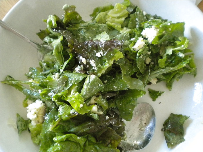 Green leaf lettuce with feta and red wine vinegar and olive oil dressing.