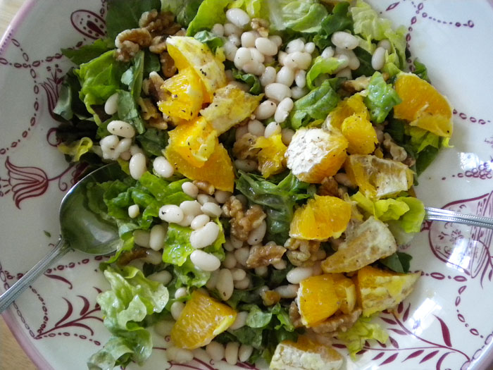 Red leaf lettuce, butter lettuce, oranges, walnuts, white beans, with white balsamic and olive oil dressing.