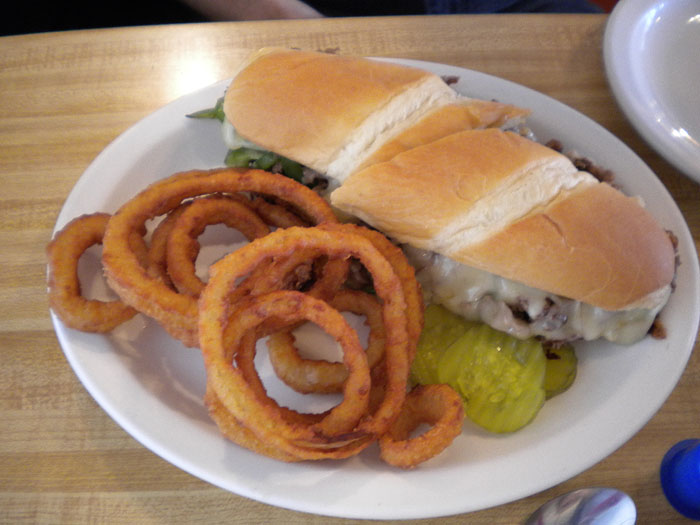 The Philly sandwich, with onion rings, at Detz Cafe, downtown Colorado Springs.
