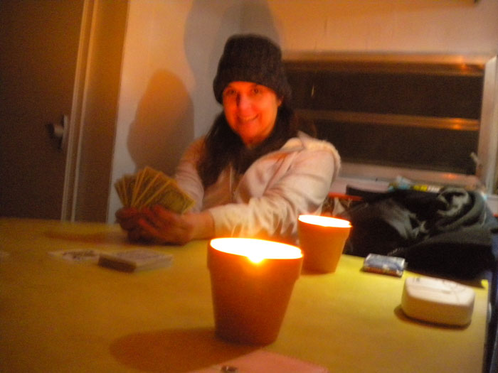 After dinner and the cupcakes, we played cards by candlelight. Adrienne also wore a hat, but it was store-bought.