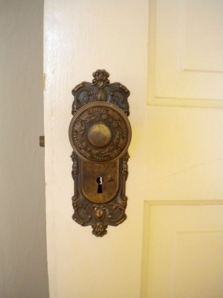 All the doors, including the front door, have these doorknobs. They also all have matching original hinges.