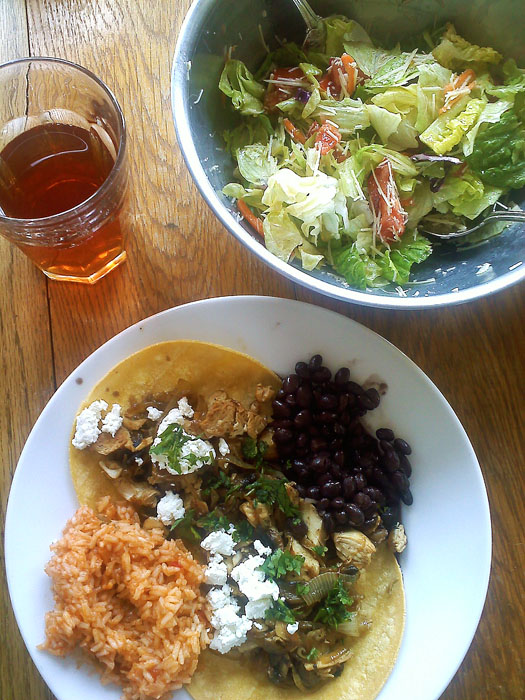 Chicken tacos: grilled chicken, carmelized onion, cilantro, and chevre. Mexican rice which is just rice cooked with Rotel tomatoes. Black beans, green salad with mixed greens, parmesan, and vinagrette.
