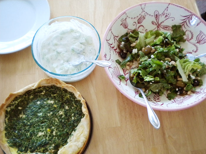 Spinach quiche with tzatziki and green salad with white beans, feta, olives, and vinagrette.