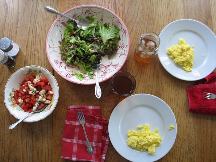 Caprese salad, scrambled eggs, and green salad with white beans and parmesan.