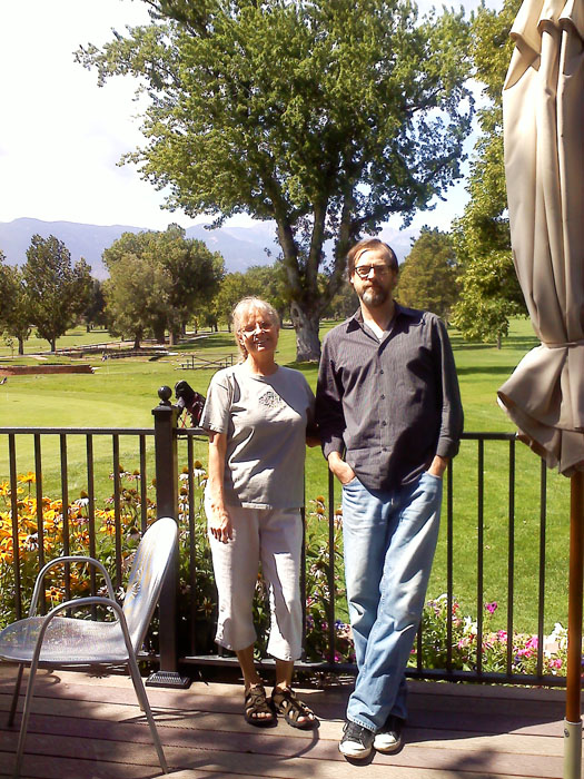 Mike's mom Linda and Mike on the patio at the Patty Jewet Gold Course Clubhouse.