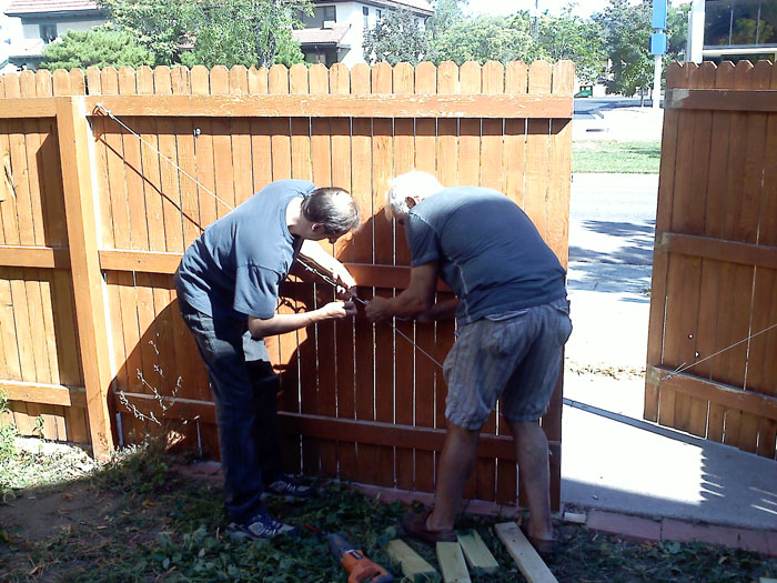Then Mike and my dad worked on making a gate in the fence. Oddly, we had a wide driveway that went to nowhere. Now we can pull the trailer into the back yard.