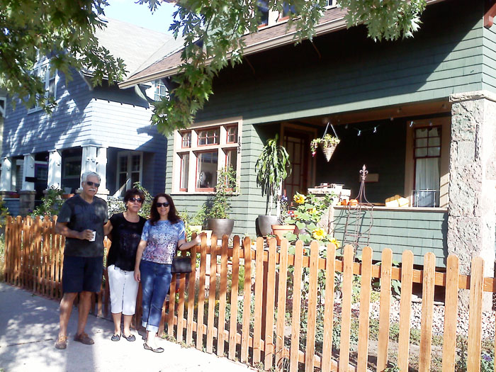 Dad, Mom, and me in front of our house, downtown Colorado Springs.