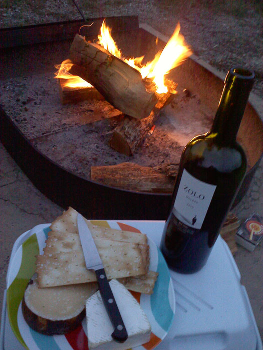 There's not much better than a campfire, a bottle of wine, and some snacks.
