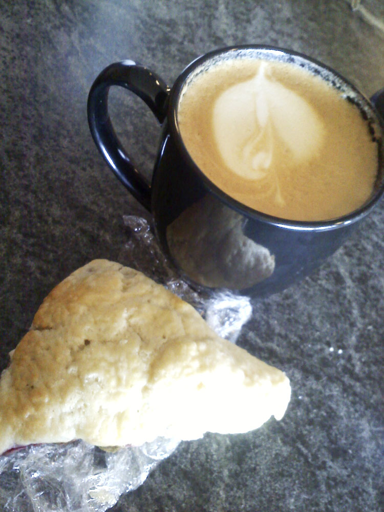 Latte and moist, yummy scone from Colorado Coffee Merchants.
