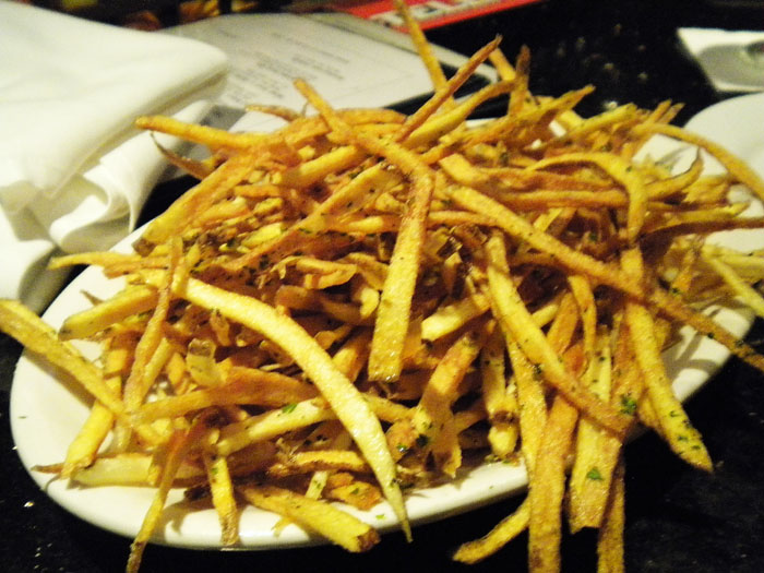 A gigantic plate of french fries at The Famous