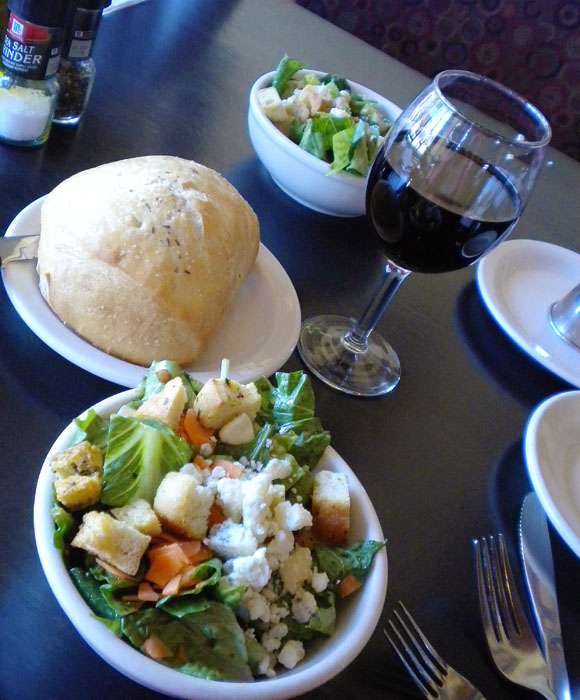 Delicious house salad with fancy bread. And of course a glass of wine!