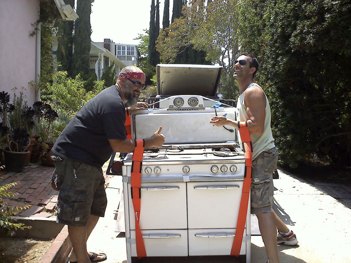 My brothers helping me ship the cool vintage stove from L.A.