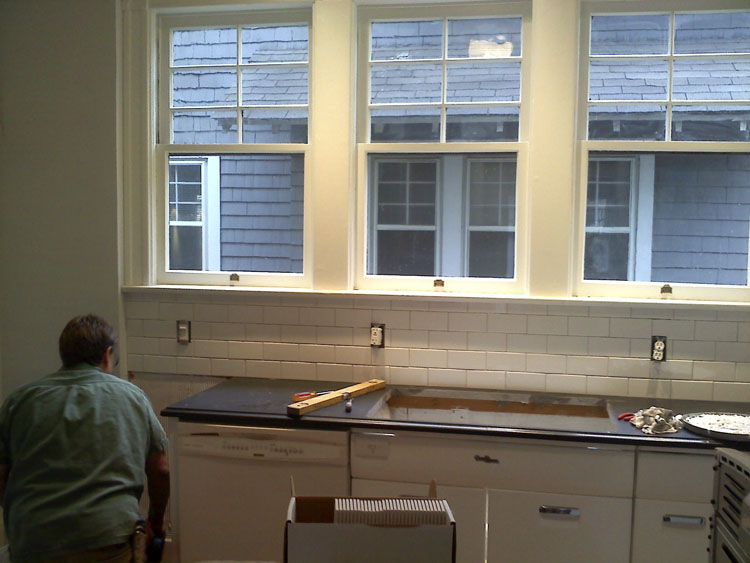 Tim The Tile Guy installing our subway backsplash