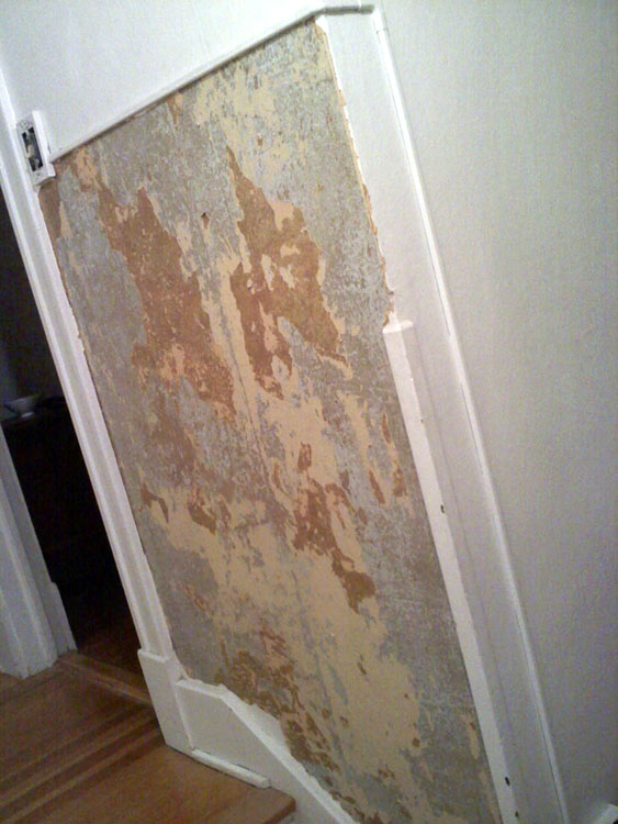The upstairs hallway wallpaper was missing in some spots, revealing this kind of original horsehair plaster (which I liked!) or was peeling off. We removed as much as we could, patched, primed, and painted.