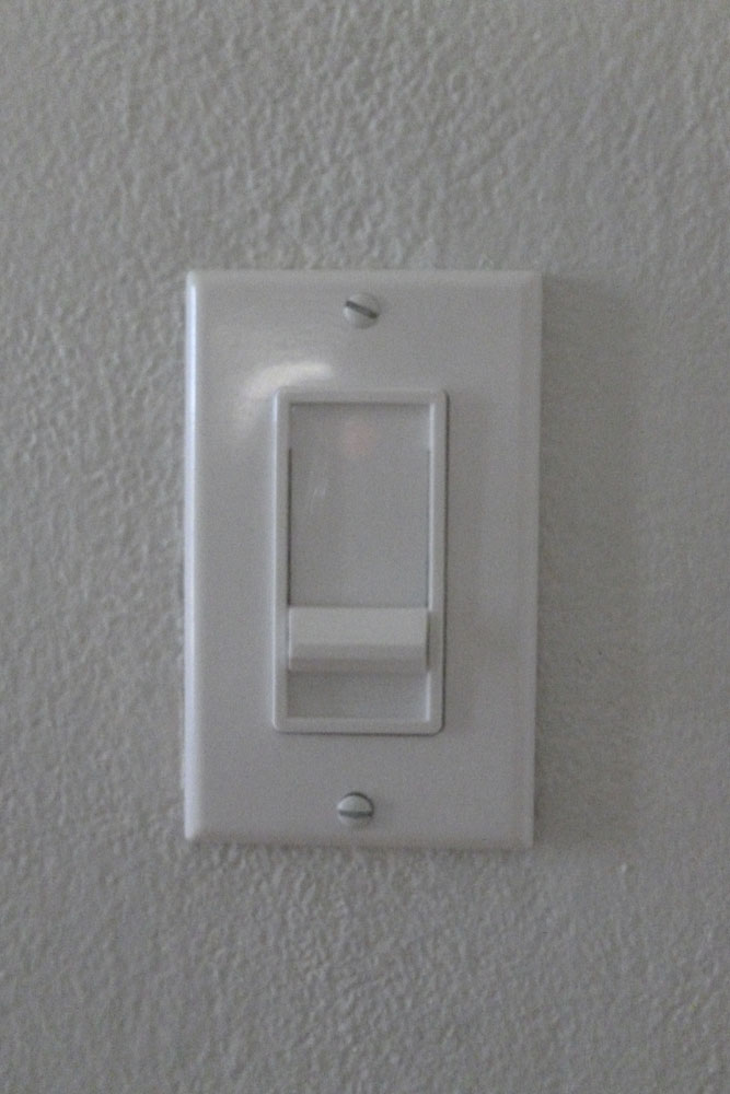 Sometimes it's the little things. We changed out the light switch to a dimmer. Also, we replaced all the off white outlet covers with white ones.
