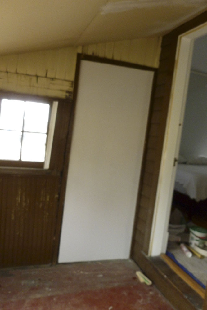 "We nicknamed this the ""door to nowhere"" and had some trouble getting financing because of it. It originally went out to an uncovered porch- our neighbor's is still intact."