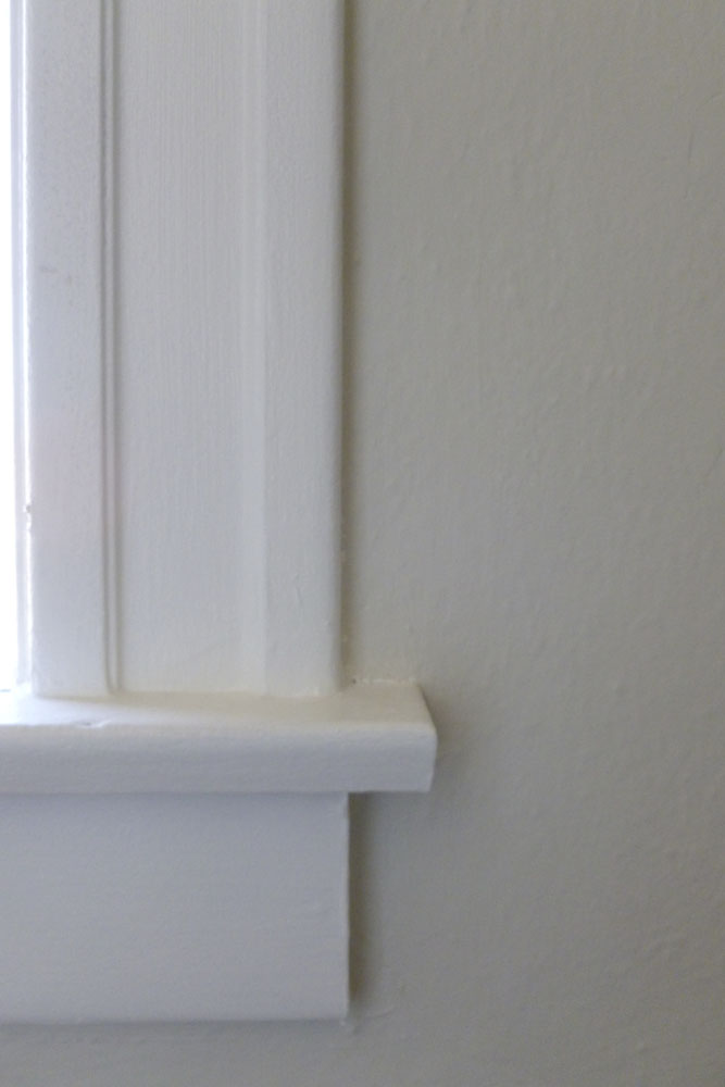 We used Benjamin Moore Old Prairie for the walls and Benjamin Moore Cotton Balls on the trim.