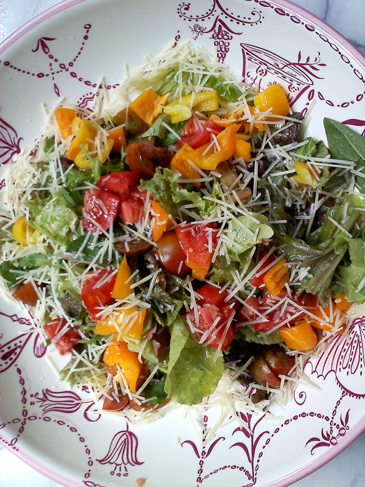 Tossed salad with tomatoes, bell peppers, and parm.