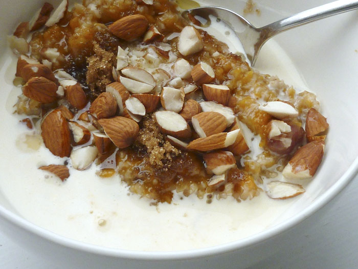 Sweet potato oatmeal with almonds, cranberries, and brown sugar.
