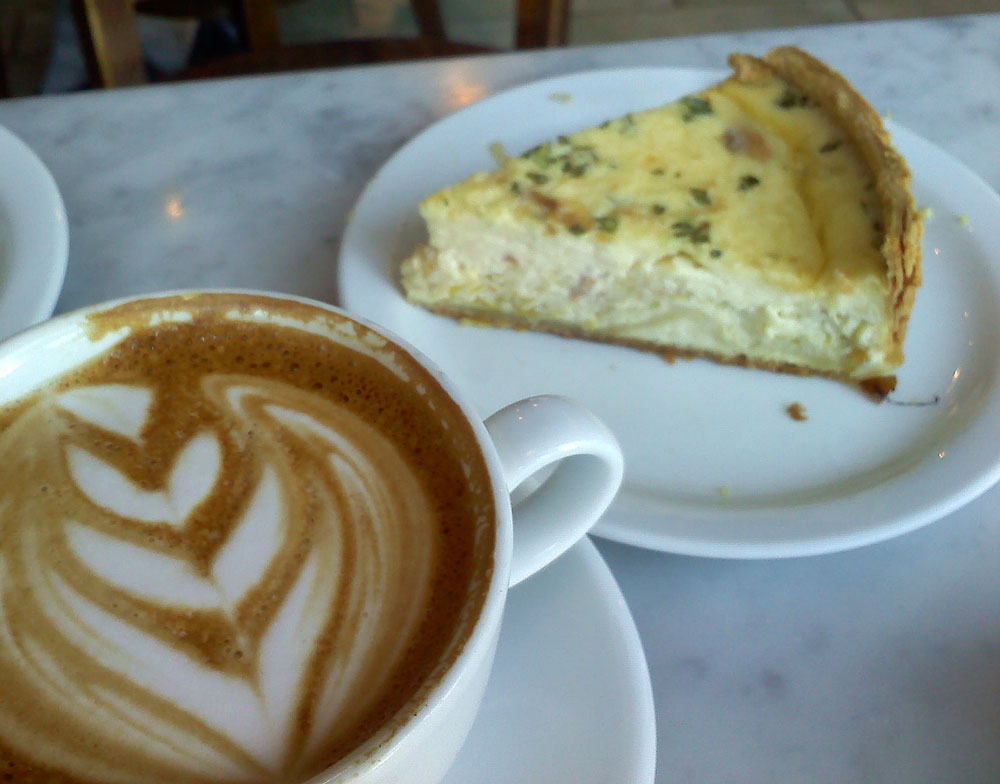 A slice of quiche and a cafe latte from Proof Bakery, Los Angeles