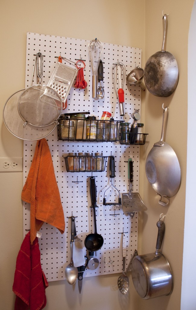 There are no drawers and not enough counter space for a utensil holder, so Mike put this pegboard up for me. I also thought it would be cute to have the pans hanging on the wall.