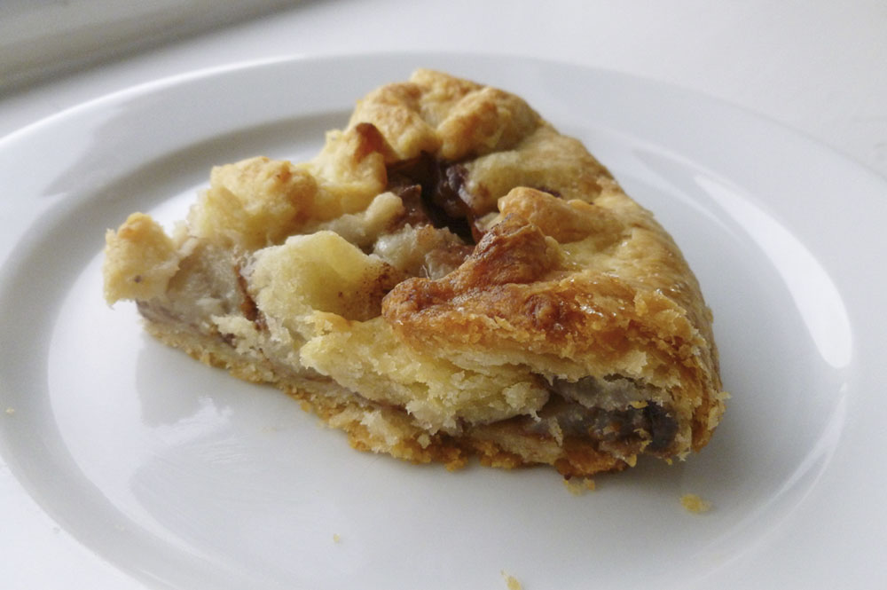 A slice of rough puff Nutella pear pie